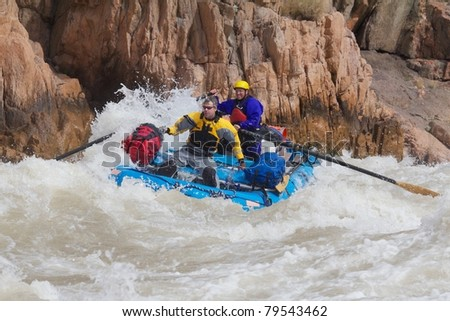 Two men Rafting the River