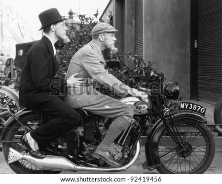 Two men riding a motorbike Zdjęcia stock ©