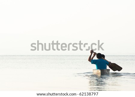 Two men sailing in a Canoe with room for text