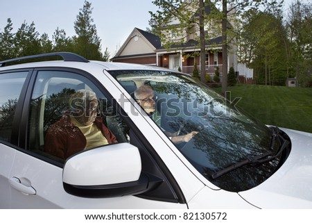 Two men setting GPS before carpooling from home