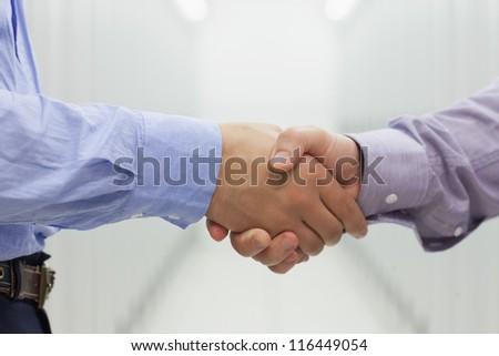 Two men shaking hands in data center