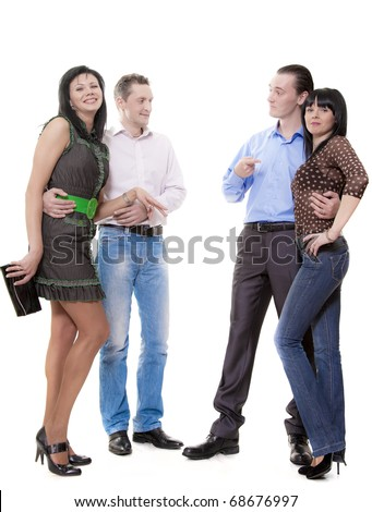 Two men show on women standing nearby
