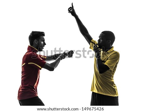 two men soccer player playing football competition exchanging jersey in silhouette on white background