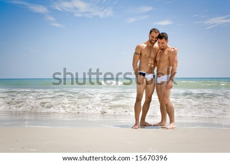 Two men standing at the beach