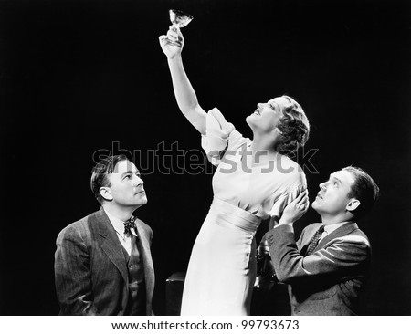 Two men supporting  a woman lifting her wine glass Zdjęcia stock ©