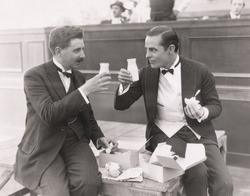 Two men toasting with milk bottles
