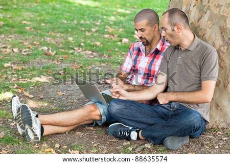 Two Men Working with Computer at Park