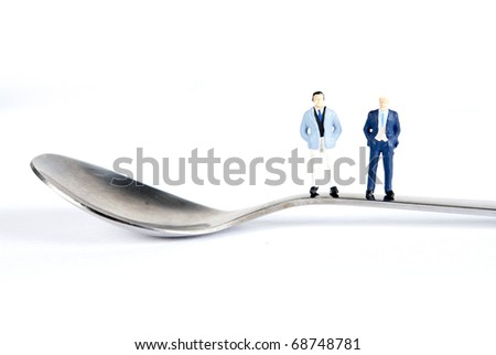 two mens on tea spoon - stock photo