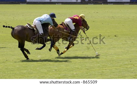 Two mens playing polo