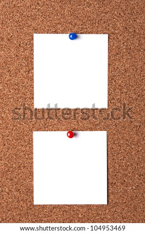 Two message papers pinned to cork board