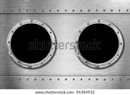 two metal ship portholes