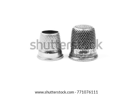 Two metal silver sewing thimbles on a white background. Sewing accessories and tools - Shutterstock ID 771076111