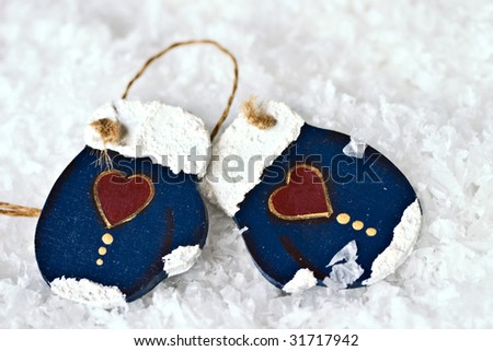 Two mittens in the snow