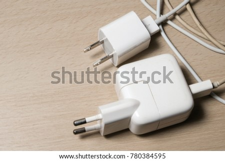 Two mobile chargers on the table. #780384595