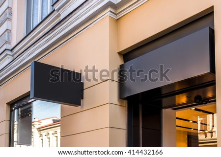 Two mock ups of restaurant street black signboards on yellow wall - Shutterstock ID 414432166