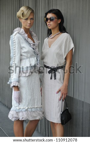 Two models wearing couture designer clothes