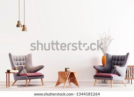 Two modern armchair in a white color background wall, living room in modern style with low table and decor. white background. 3d rendering