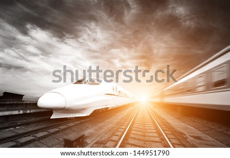 two modern high speed train with motion blur #144951790