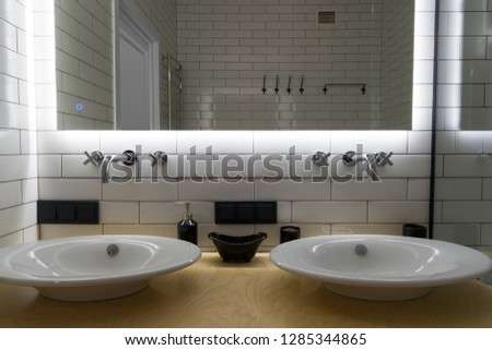 Two modern sink in the bathroom, and big mirror #1285344865