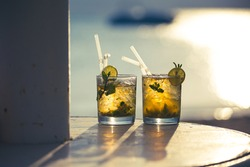 Two mojito cocktails against the sunset light on the beach, Egypt