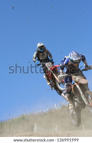 Two Motocross motorcycles jump : Shutterstock