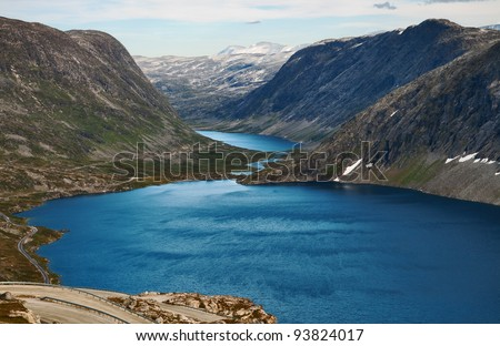 Two mountain lakes with dark blue water