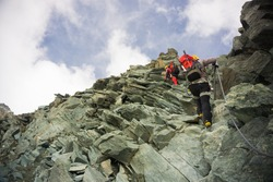 Two mountaineers on the ridge climbing Grossglockner, Austria