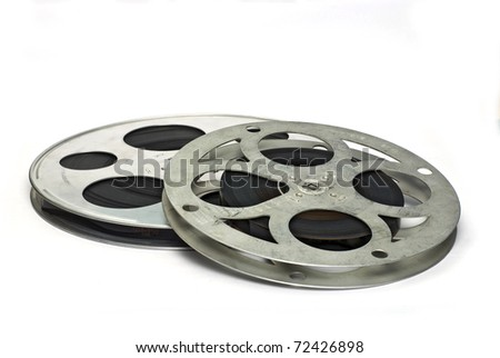 Two movie film reels; isolated on white ground - stock photo