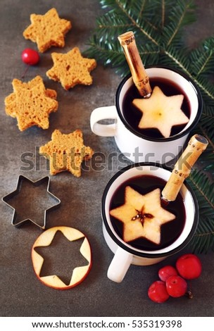 Stock Photo Two mug of hot red mulled wine spices and gingerbread. Toned image