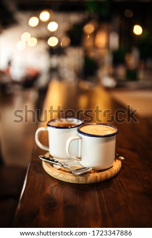 Two mugs with morning coffee on a wooden board on the table, vertical Stok fotoğraf ©