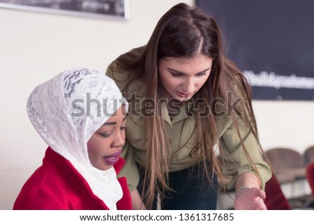 Two multiethnic female startup business african american and european woman working everyday job at modern coworking office space looking at innovative project suggesting creative solution to client.