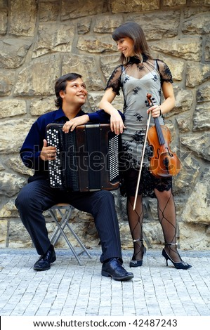 Two musicants with instruments