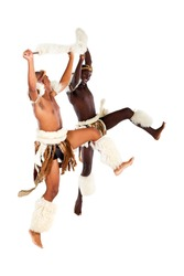 two native african tribal man performing traditional dance, isolated on white