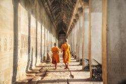 Two neophytes walking in an Angkor Wat, Siem Reap, Cambodia.