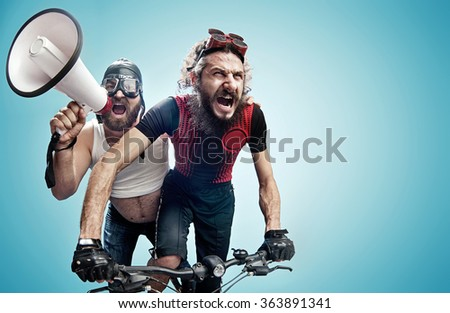 Two nerdy guys with a megaphone #363891341