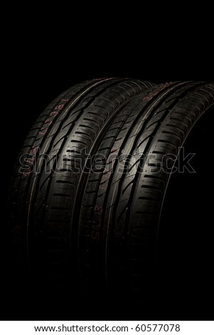 Two new car tires close up