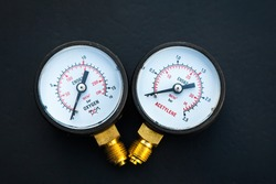 Two new manometers for acetylene and oxygen on a black background.