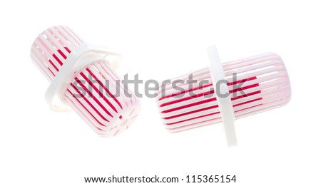 Two new toilet bowl cleaners and deodorizers in plastic housing on a white background.