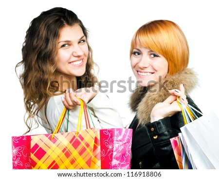 Two nice happy teenage girls on a shopping