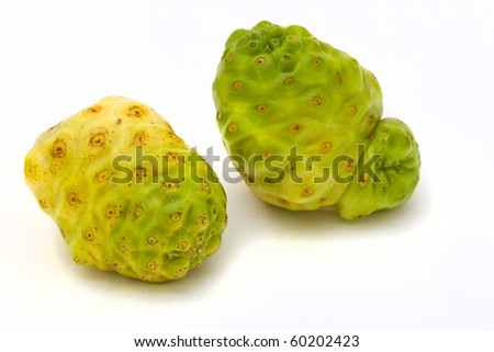 Two noni mulberry fruit on white background.