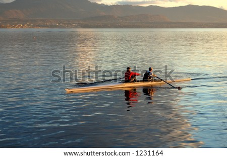 Two oarsmen, practising at St Prex, on Lac Léman (Lake Geneva) in the evening.