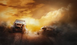 Two off road vehicles coming out of a mud hole hazard in off-road  competition.