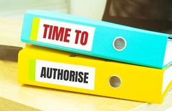 Two office folders with text TIME TO AUTHORISE
