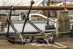 two old anchors on wooden dock