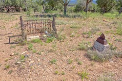Two old and neglected graves in the historic Puntenney Cedar Glade Cemetery near Drake Arizona.