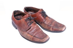 two old boots of brown color on a white background