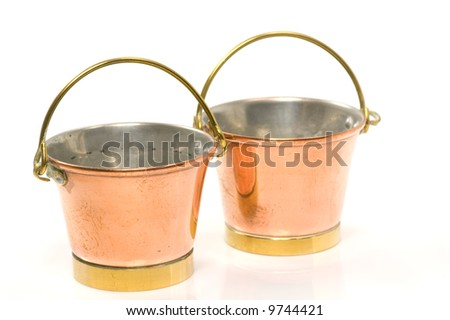 Two old copper buckets - stock photo