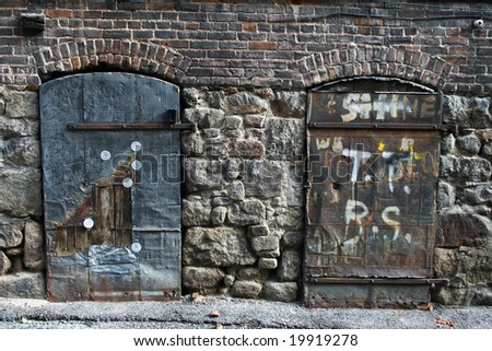 Two Old Doors against a Stone and brick wall in Butte, Montana.