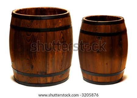 Two old fashioned whisky barrel and wine cask wood containers over white