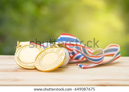 two old gold medal and golf ball on wood in morning, soft background, Winner concept #649087675